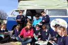 Emma Kite and Mark Wadey visit children at Upton Junior School to promote their book with a blue campervan