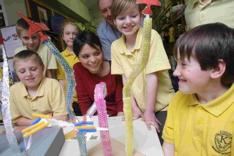 DESIGNS: Emma Egging visited Kinson Primary School, she is pictured chatting to Dylan Newbury