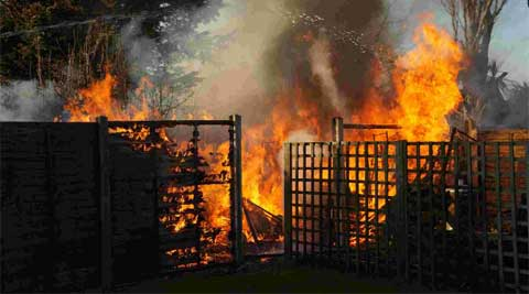 BLAZE SCENE: The Garden Fire At Baring Road In Southbourne. Picture: Mike  Ellson