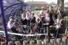 PLEASED: Children cut a ribbon to mark the arrival of the new bike and trike shed on their school grounds with Year Three teacher Ben Morgan Picture: Hattie Miles