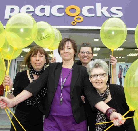 CELEBRATE: Assistant Manager of the Peacocks store in Ashley Road in Parkstone Lenanda Leighton, centre, with staff at the reopening