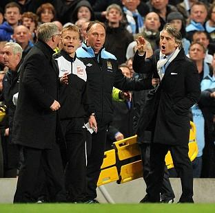 Bournemouth Echo: Sir Alex Ferguson (left) and Roberto Mancini (right)