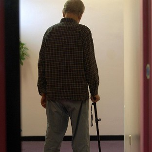 A care worker has been sacked after an elderly man was given a dog biscuit - which he ate - during a therapy session