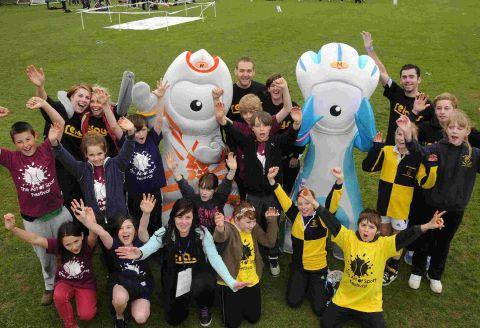 Bournemouth Echo: GAMES ON: Youngsters from Colfox School and St Osmunds  School with Olympic mascots Wenlock and Mandeville