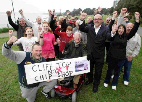 Residents celebrate the council dropping plans to put a snack bar at West Cliff Green