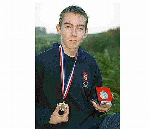 Tragedy: Jake Holden as a prize-winning teenage marksman in October 2000