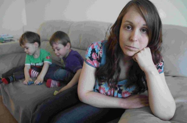 LIVES TURNED UPSIDE DOWN: Clare Scott and her sons Ben, four, and, left, Josh, two