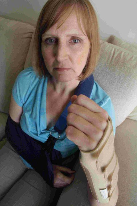 LEFT IN AGONY: Janis Perkins who was knocked over by a dog at the play park at Kinson Community Centre