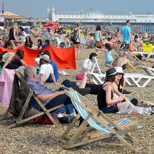 Bournemouth Echo: People enjoy the warm weather on Brighton beach