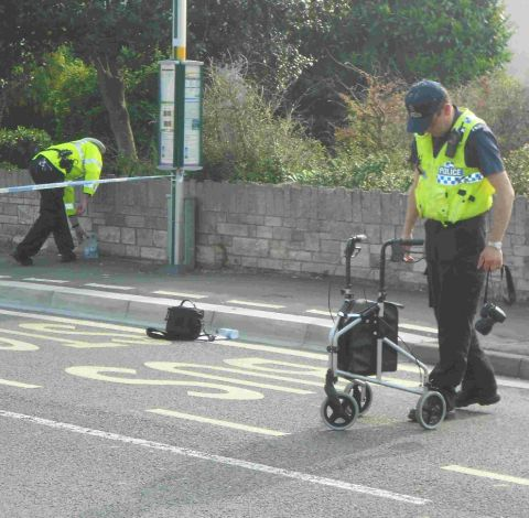 Police officers on Dorchester Road where an elderly woman was seriously injured