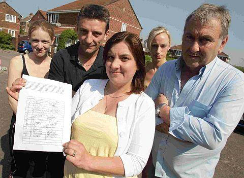 OPPOSITION: Kate Revuelta, front, with a petition from fellow residents of Churchill Gardens