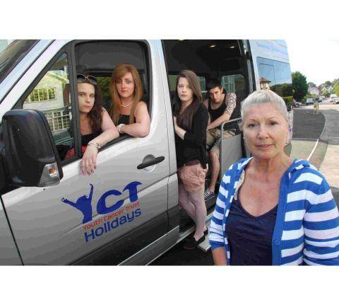 Brenda Clark, founder of the Youth Cancer Trust with some of the young guests with the minibus that has been vandalised