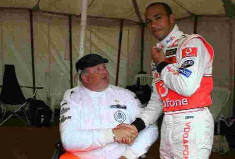 Steve Tarrant, who was badly injured in a collision and is now aiming to achieve a world record for the greatest distance covered in 24 hours on a mobility scooter, meeting F1 star Lewis Hamilton