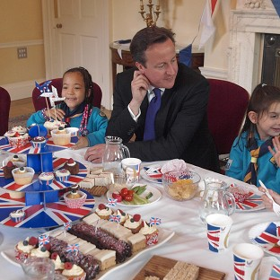 Prime Minister David Cameron with scouts at the Downing Street Jubilee party at 10 Downing Street