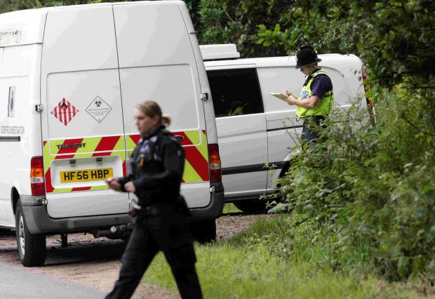 Police search an area near Lytchett Matravers