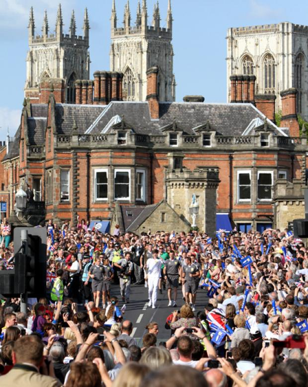 Bournemouth Echo: The Olympic torch comes over Lendal Bridge .