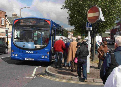ROUTE ROW: Broadstone residents queue to catch the No 3 Wilts and Dorset bus from The Broadway