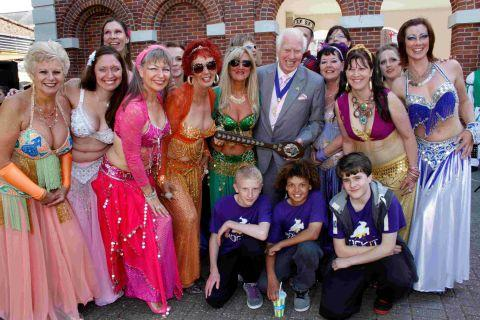 Christchurch mayor Peter Hall presents his award to Jan's Gems and Rock It Crew in Saxon Square