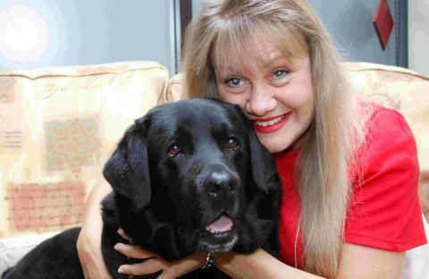 SAVED: Suzanne West, from Creekmoor, with Herbie the guide dog who saved her life