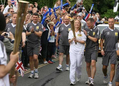 St Mark's School teacher Jacqui Seymour carries the torch in Christchurch. Picture: Richard Crease.