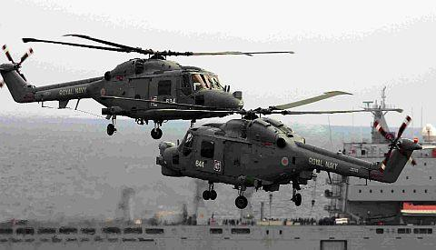 TREAT: The Royal Navy Black Cats Helicopter Display Team will take to the skies at this year's Bournemouth Air Festival. Below, the award winning RAF Chinook Mk2