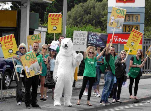 Greenpeace campaigners outside the Shell garage at Barrack Road in Christchurch protest against the company's plans to drill for oil in the Arctic