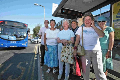 FARES PLEASE: Cllrs Susan Jefferies and Mike Brooke with Broadstone residents waiting for the bus and, inset below, Ed Wills of Wilts & Dorset