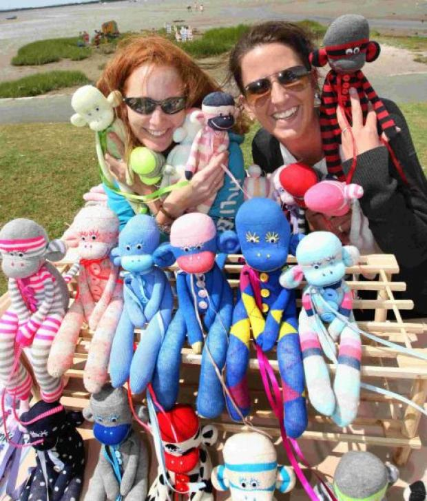 MONKEYING AROUND: Jo Felts, right, with her collection of sock monkeys and her friend Gemma Fordham