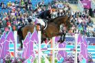 MEDAL TRIUMPH: William Fox-Pitt in action on Lionheart in this afternoon's showjumping round at Greenwich Park