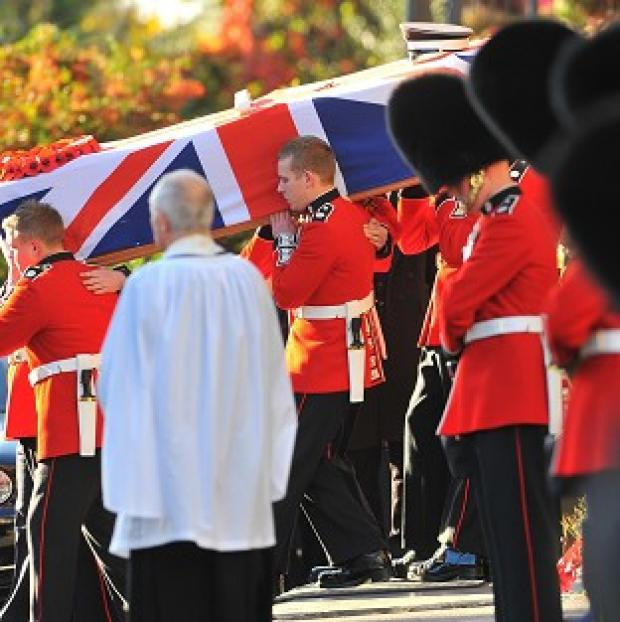 Bournemouth Echo: The funeral of L/Cpl James Hill at Redhill, Surrey, in October 2009