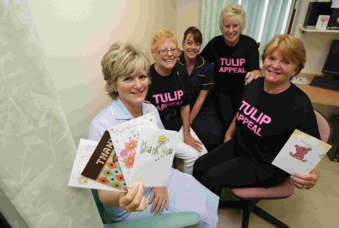 Breast prosthetic fitter Jayne Hustler, left, and clinical nurse specialist Christine Weight with trustees of the Tulip Appeal