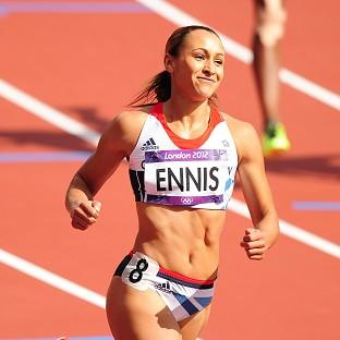 Jessica Ennis began her Olympic heptathlon campaign with a record time in the hurdles