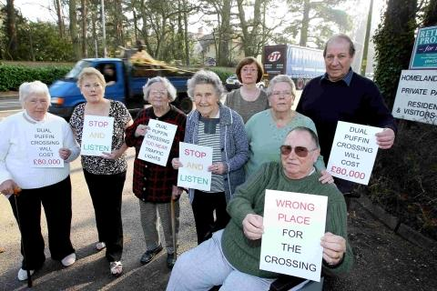 Rodney Darrington, far right, and other residents from Homelands House in Ferndown, are protesting against plans for an £85,000 crossing on Ringwood Road. They argue that the crossing would be much better at the Victoria Road crossroads