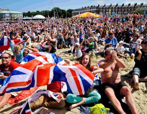 Bournemouth Echo: CELEBRATION: Happy scenes at the Live site on Weymouth beach