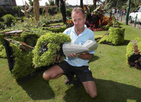 DISGUSTED: Head gardener Robin Garrett in the vandalised garden
