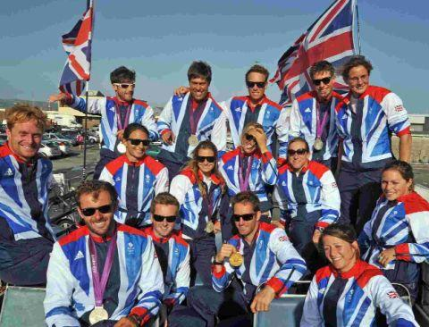 CELEBRATION: Team GB sailors, including Poole's Annie Lush and Lucy and Annie Macgregor, on the open-top bus tour
