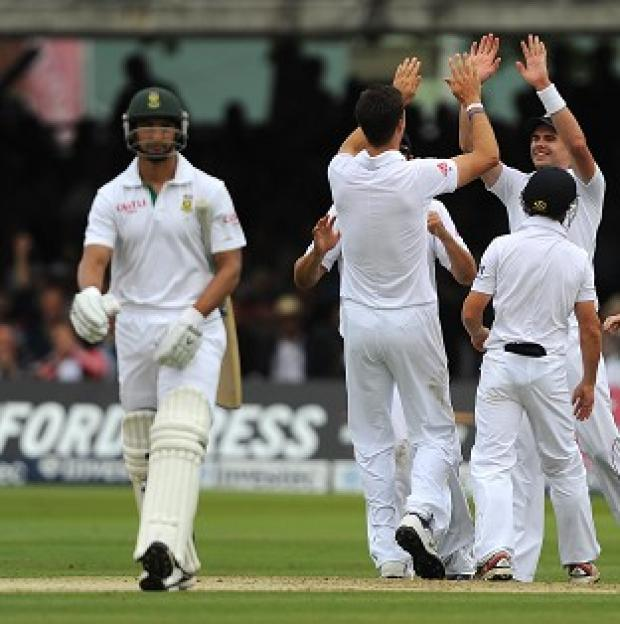 England celebrate taking the wicket of Alviro Petersen at Lord's