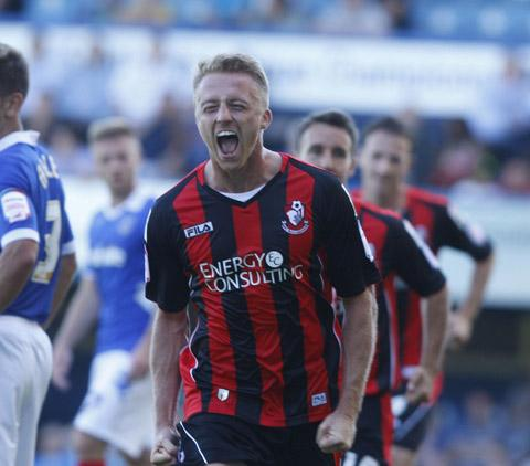 GOAL: Lee Barnard celebrates making it 1-1 at Fratton Park