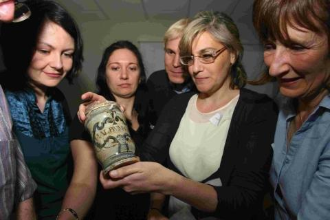 Paola Palma shows off an early 17th century apothecary jar found in the Swash Channel Wreck outside Poole Harbour