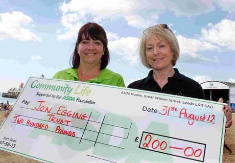 FUNDRAISERS: Dawn Egging, right, receives a cheque for £200, for the Jon Egging Trust, from Amanda Bailey.  Left, Jon Egging  Picture: Hattie Miles 15033542