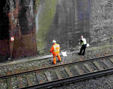 PROBE: Emergency services attend an incident at Pokesdown Station where a woman fell from the Christchurch Road bridge over the train tracks. Picture: Corin Messer