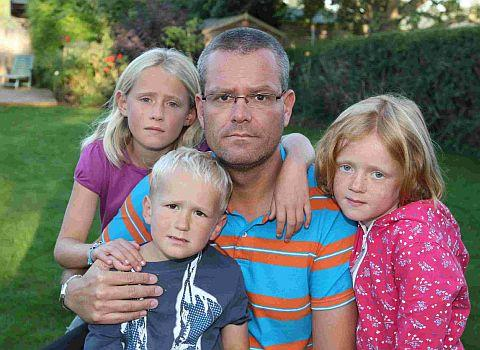 ANGUISH: Simon Hill from Wimborne and his children  Catherine, 8, Edward, 3