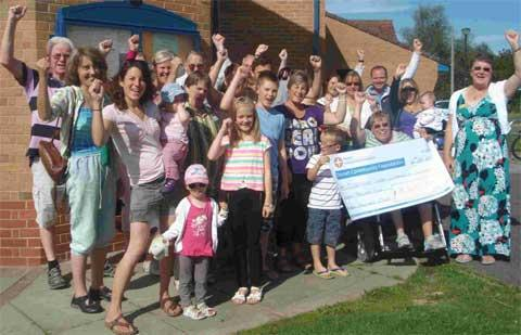 CHEQUE: Residents and trustees celebrating the funding success