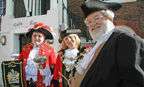 RINGING A BELL: Poole Town Crier, David Squires, with Mayor of Poole, Cllr Carol Evans and organiser Brian Galpin. Picture: Jon Beal.