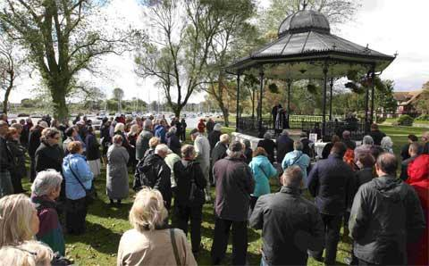 CARING: A crowd gathers for the open air farewell service to Cliff Cunningham at the bandstand on Christchurch Quay. Picture: Richard Crease