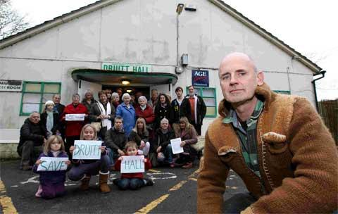 KNIGHT: Chairman of the Friends of Druitt Hall committee, David O'Sullivan, front, is joined by other members of all ages as they fight to save the hall from demolition.