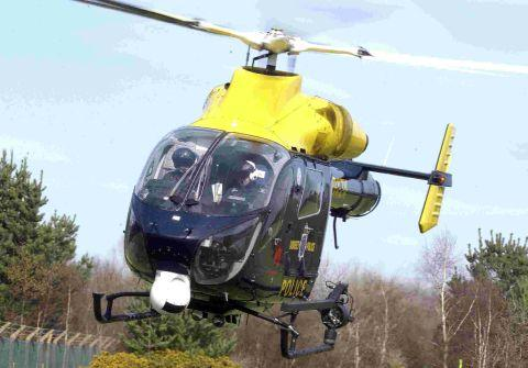 Police helicopter joins search after 'man fires air gun in woods'