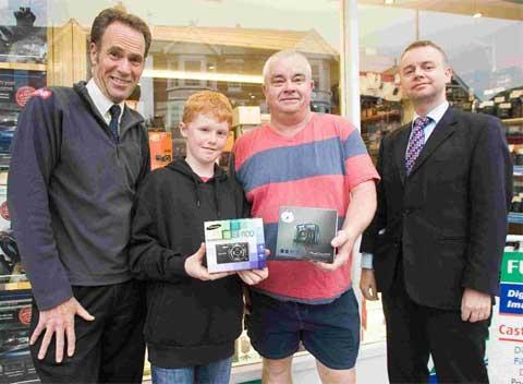 SNAP HAPPY: Matthew Le Riche and Geoff Taylor receive their prizes from Castle Cameras' Brian Callow, left, and the Daily Echo's Darren Slade