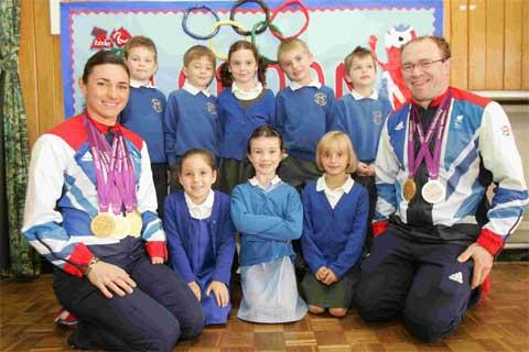MEDALS: Sarah and Barney Storey with pupils. Picture: Jon Beal, ID: 15217768