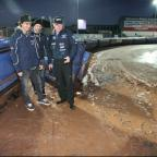 Bournemouth Echo: SOAKED: Chris Holder, Ludvig Lindgren and Neil Middleditch on track this evening